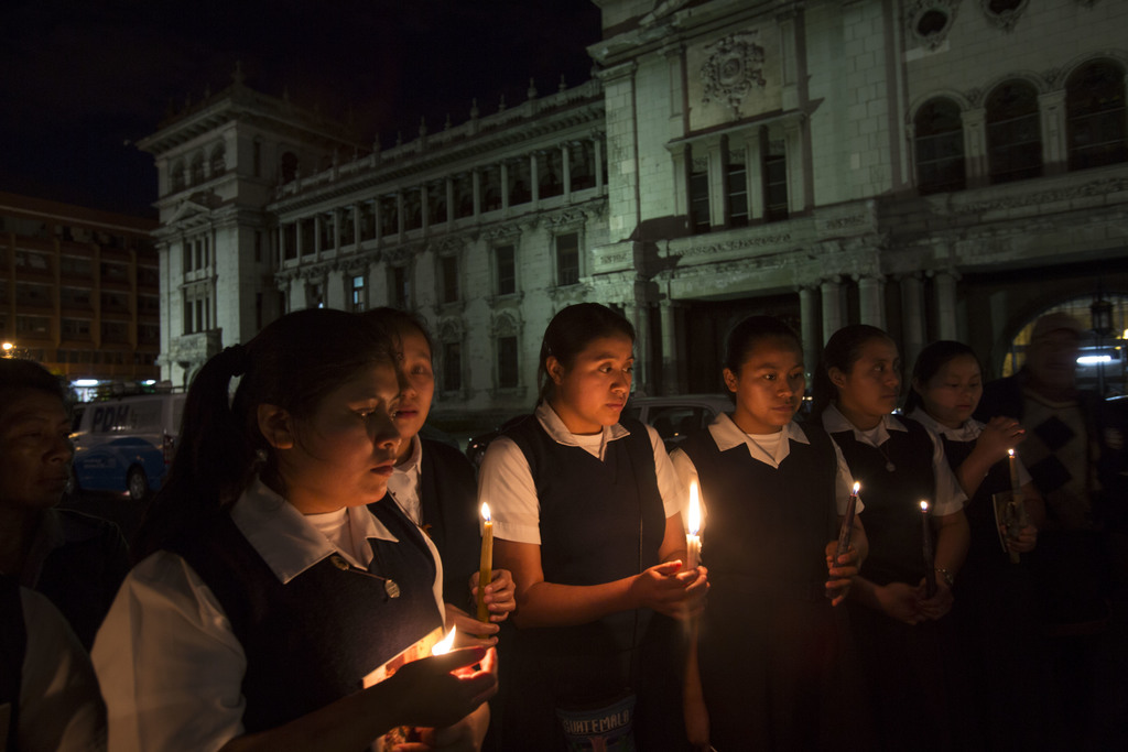 Catholic nuns hold a candlelight vigil outside the National Palace in remembrance of the girls who died in a fire at the Virgin of the ...