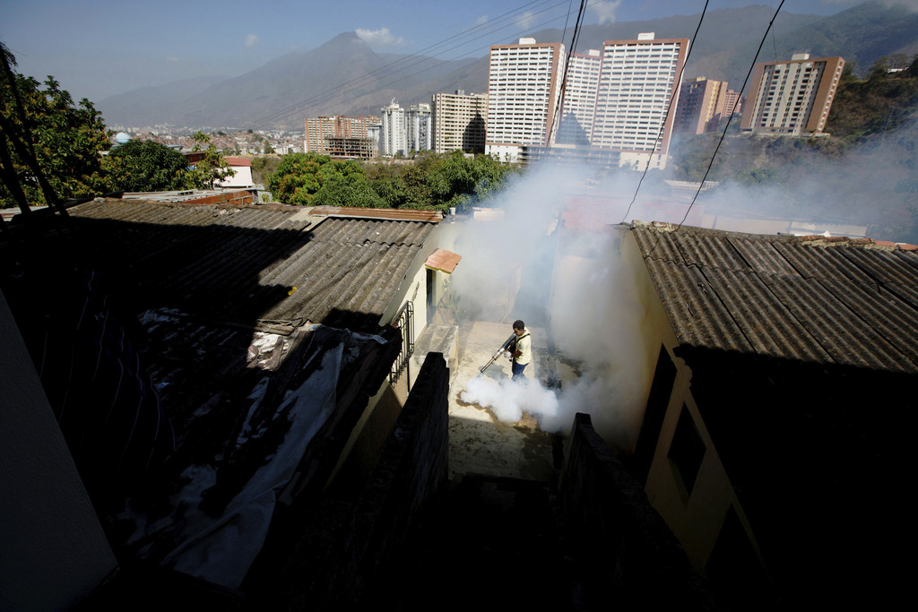 FILE - In this Monday, Feb. 1, 2016 file photo, a Sucre municipality worker fumigates for Aedes aegypti mosquitoes that transmit the Zi...
