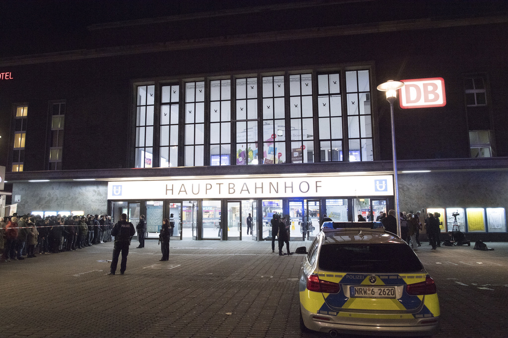 Police officers stand outside the Duesseldorf, western Germany, main station Thursday, March 9, 2017 after several people had been inju...