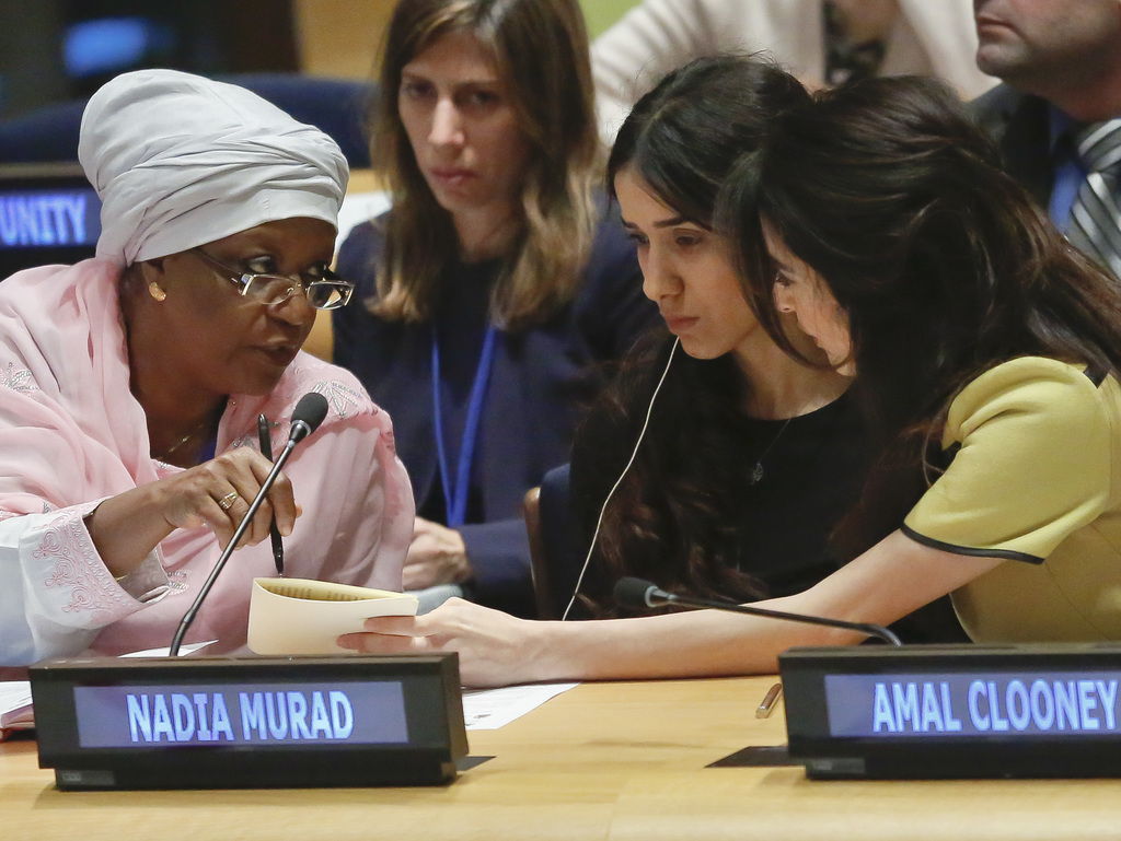 Zainab Hawa Bangura, left, special representative of the United Nations Secretary General for Sexual Violence in Conflict, confers with...