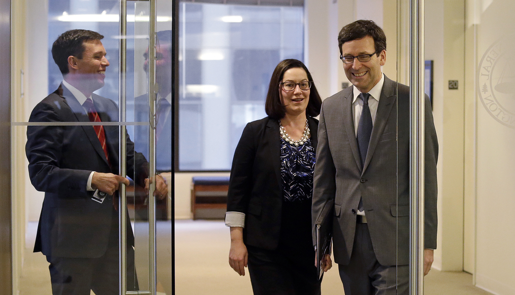 Washington State Attorney General Bob Ferguson, right, arrives for a news conference about the state's response to President Trump's re...