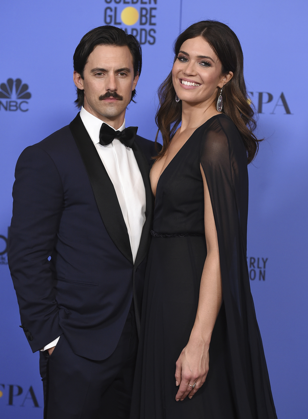FILE - This Jan. 8, 2017 file photo shows Milo Ventimiglia, left, and Mandy Moore in the press room at the 74th annual Golden Globe Awa...