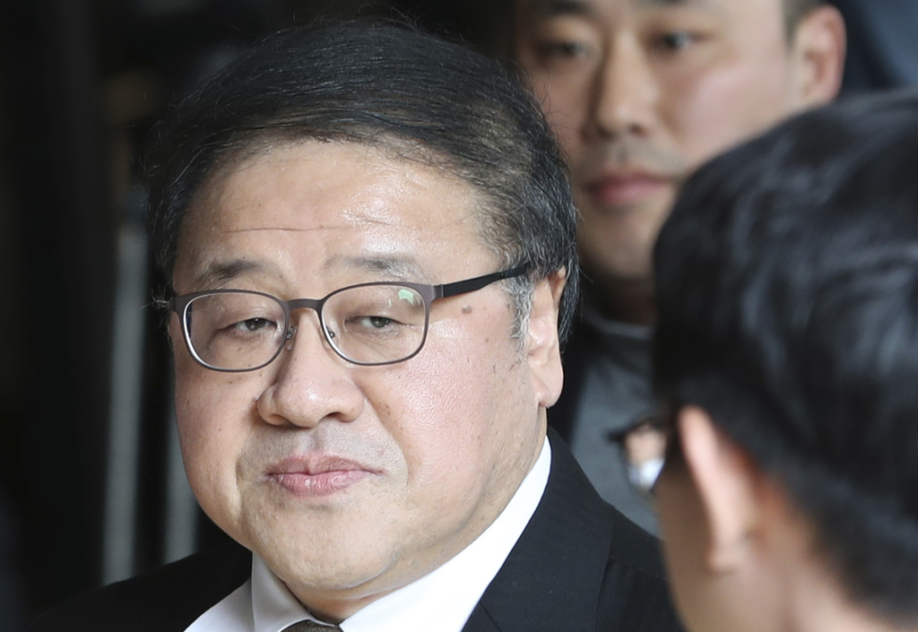 FILE - In this Nov. 2, 2016 file photo, a former presidential secretary Ahn Jong-beom arrives for questioning at the Seoul Central Dist...