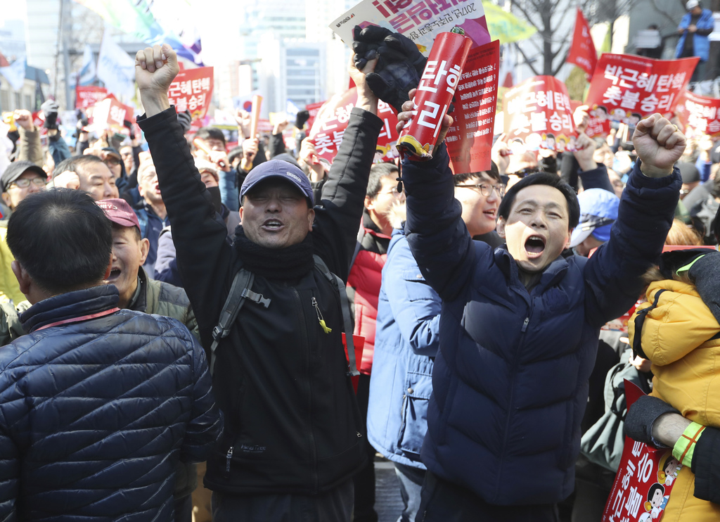 Protesters react after hearing the Constitutional Court's verdict during a rally calling for impeachment of President Park Geun-hye nea...