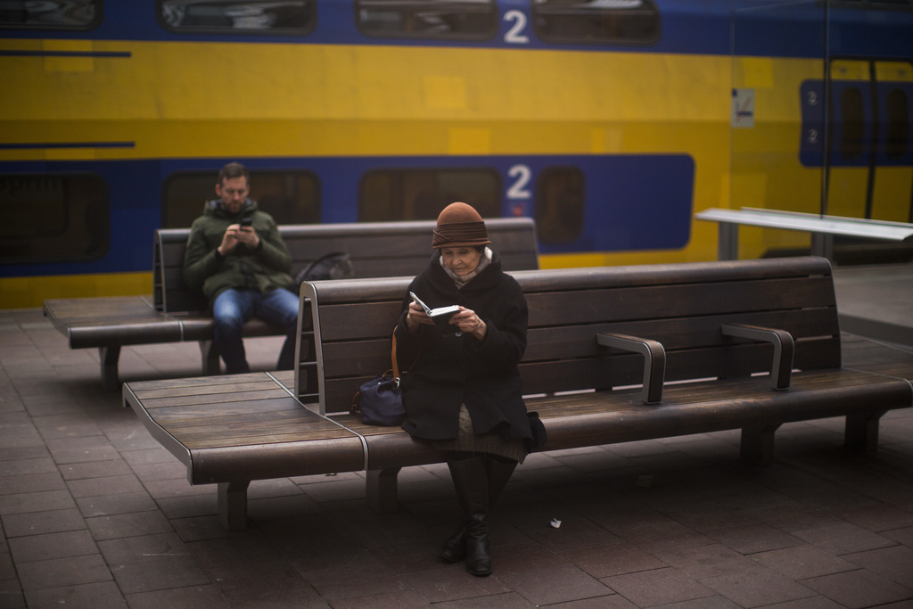 In this Thursday, March 2, 2017 photo, a woman reads the bible at the central station in The Hague, Netherlands.  (AP Photo/Emilio More...