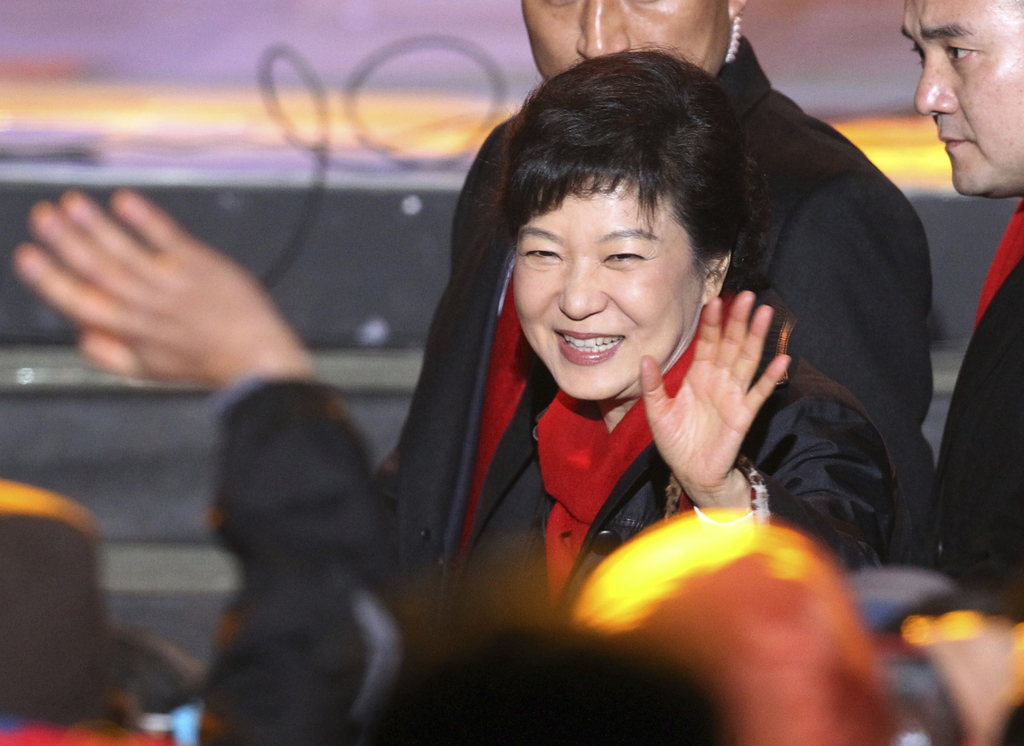 FILE - In this Dec. 19, 2012 file photo, South Korea's president-elected Park Geun-Hye waves as she arrives to give her victory speech ...