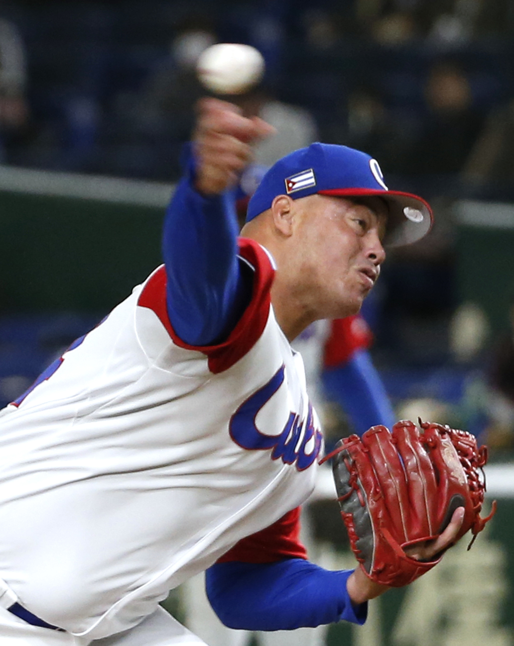 Cuba's closer Miguel Lahera pitches against Australia in the ninth inning of their first round game of the World Baseball Classic at To...