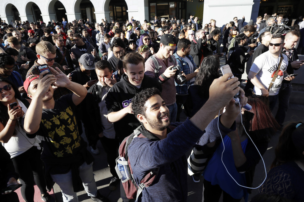 "FILE - In this Wednesday, July 20, 2016, file photo ""Pokemon Go"" players begin a group walk along the Embarcadero in San Francisco.  Di..."