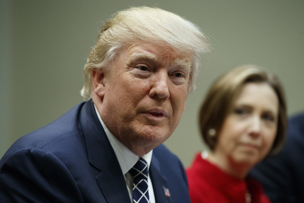 Cape Cod Five Cents Savings Bank CEO Dorothy Savarese listens at right as President Donald Trump meets with leaders from small communit...