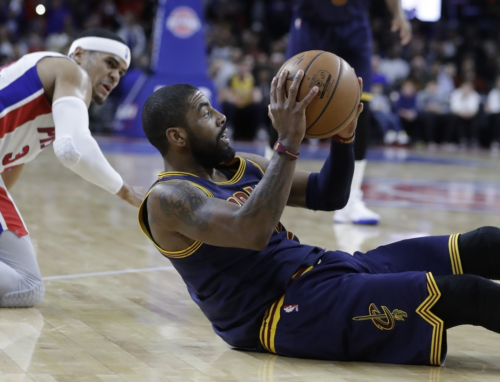 Cleveland Cavaliers guard Kyrie Irving passes the ball during the second half of the team's NBA basketball game against the Detroit Pis...