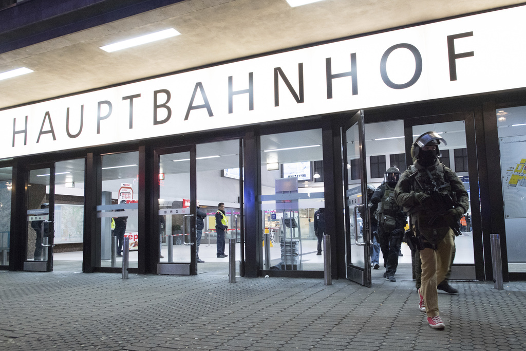 Special police forces leave the Duesseldorf, western Germany, main station Thursday, March 9, 2017 after several people had been injure...