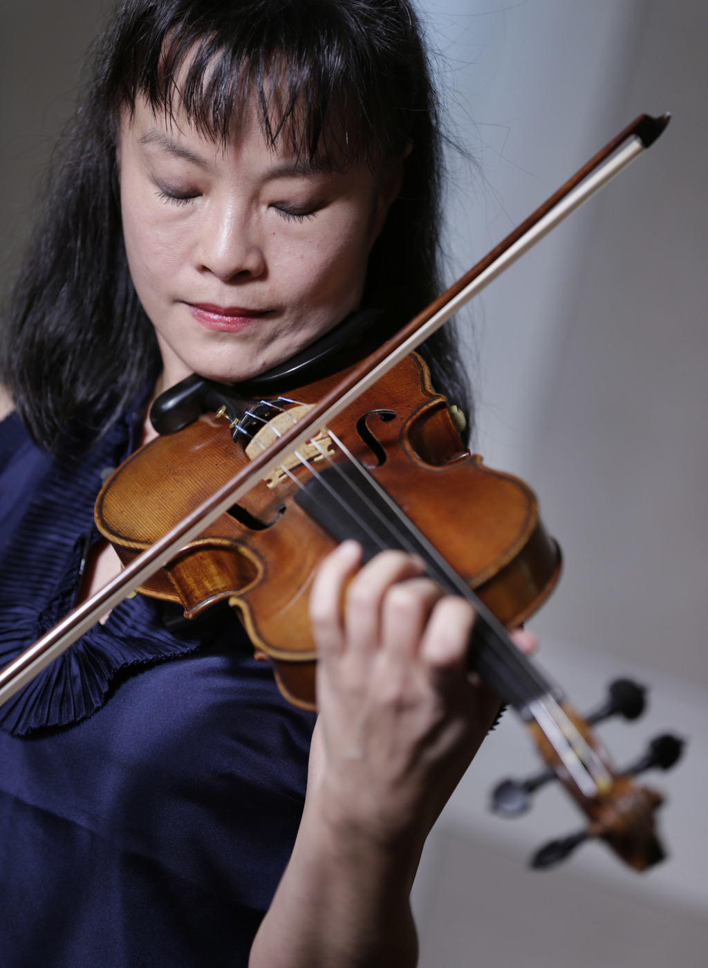 In this Wednesday, March 8, 2017 photo, violinist Mira Wang plays the Ames Stradivarius violin in New York. After a meticulous restorat...