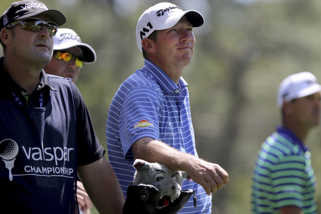 Jim Herman, center, watches Billy Horschel's drive on the ninth hole during the first round of the Valspar Golf Championship in Palm Ha...