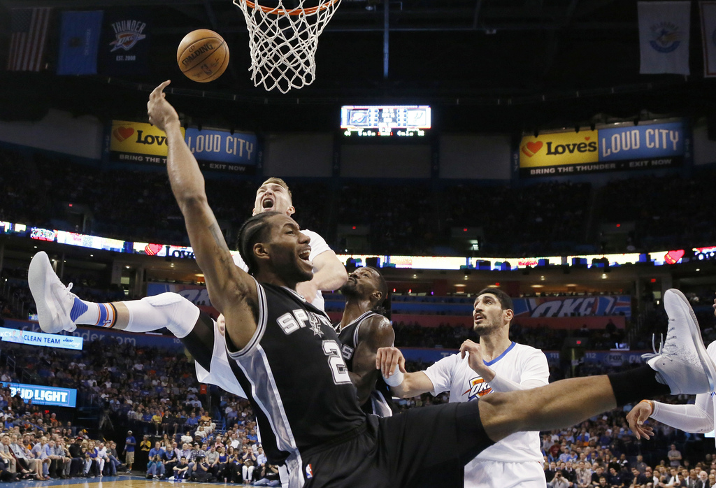 San Antonio Spurs forward Kawhi Leonard (2) loses the ball after a foul by Oklahoma City Thunder forward Domantas Sabonis, left rear, d...