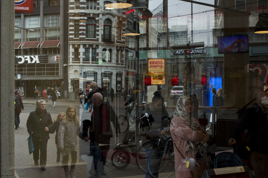 In this Friday, March 3, 2017 photo, people are seen reflected in a restaurant window in The Hague, the Netherlands. Of The Netherlands...