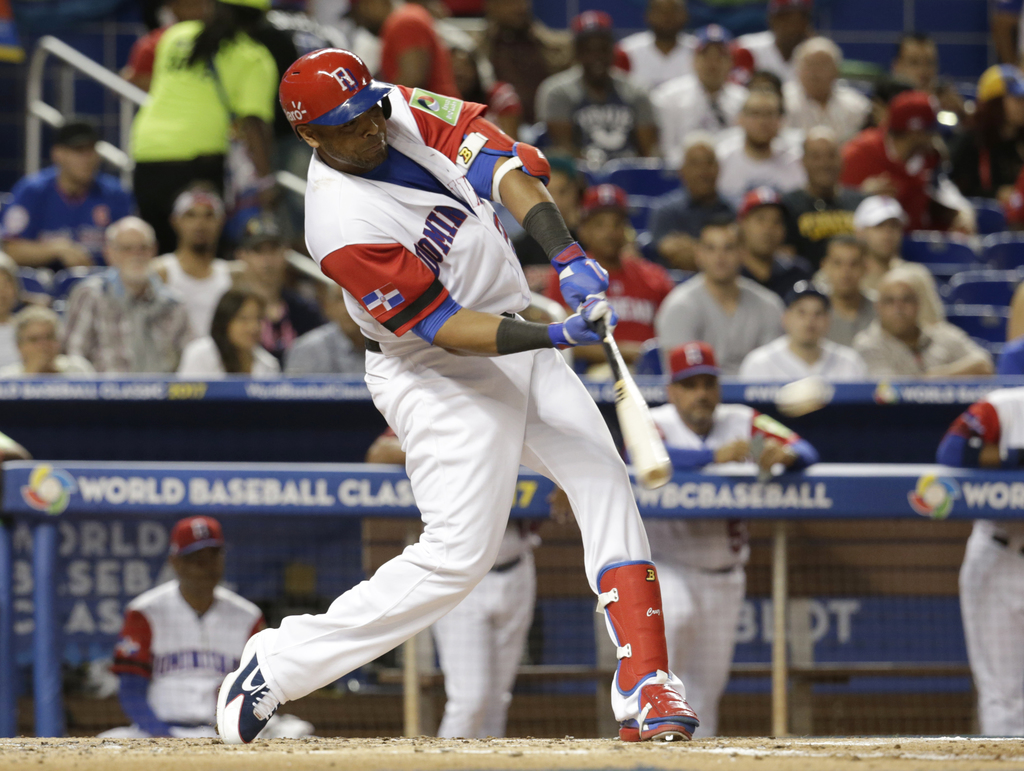 Dominican Republic's Nelson Cruz hits a double against Canada during the second inning in a first-round game of the World Baseball Clas...