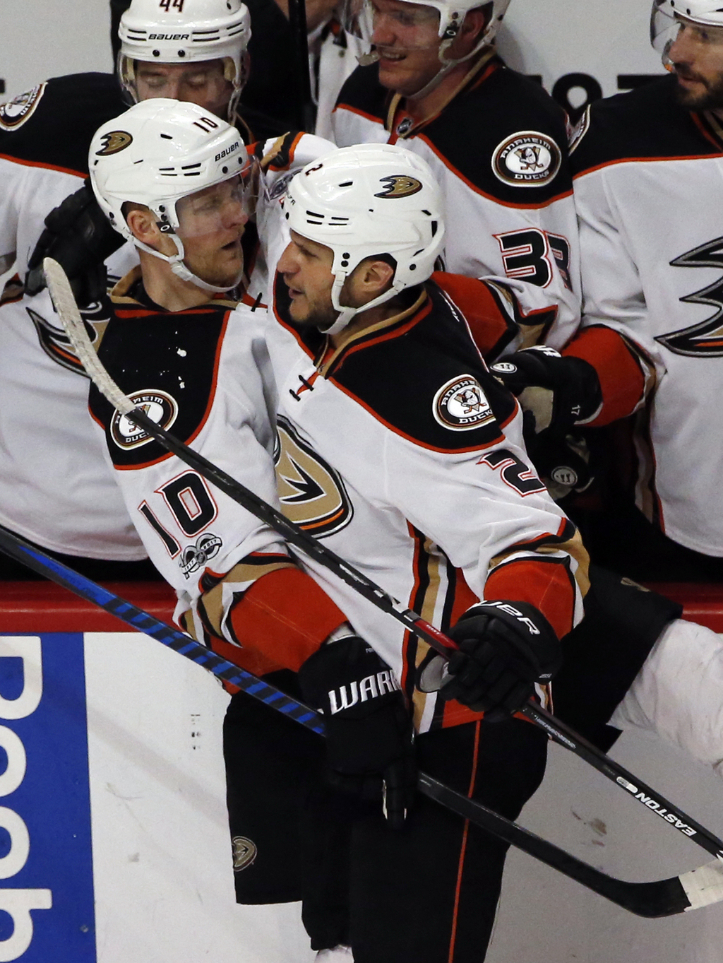 Anaheim Ducks right wing Corey Perry (10) celebrates with defenseman Kevin Bieksa (2) after scoring his goal against the Chicago Blackh...