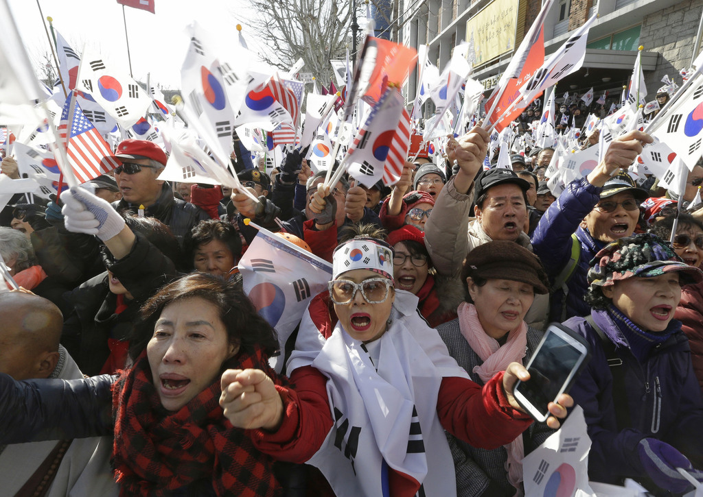 Supporters of South Korean President Park Geun-hye shout slogans during a rally opposing her impeachment near Constitutional Court in S...