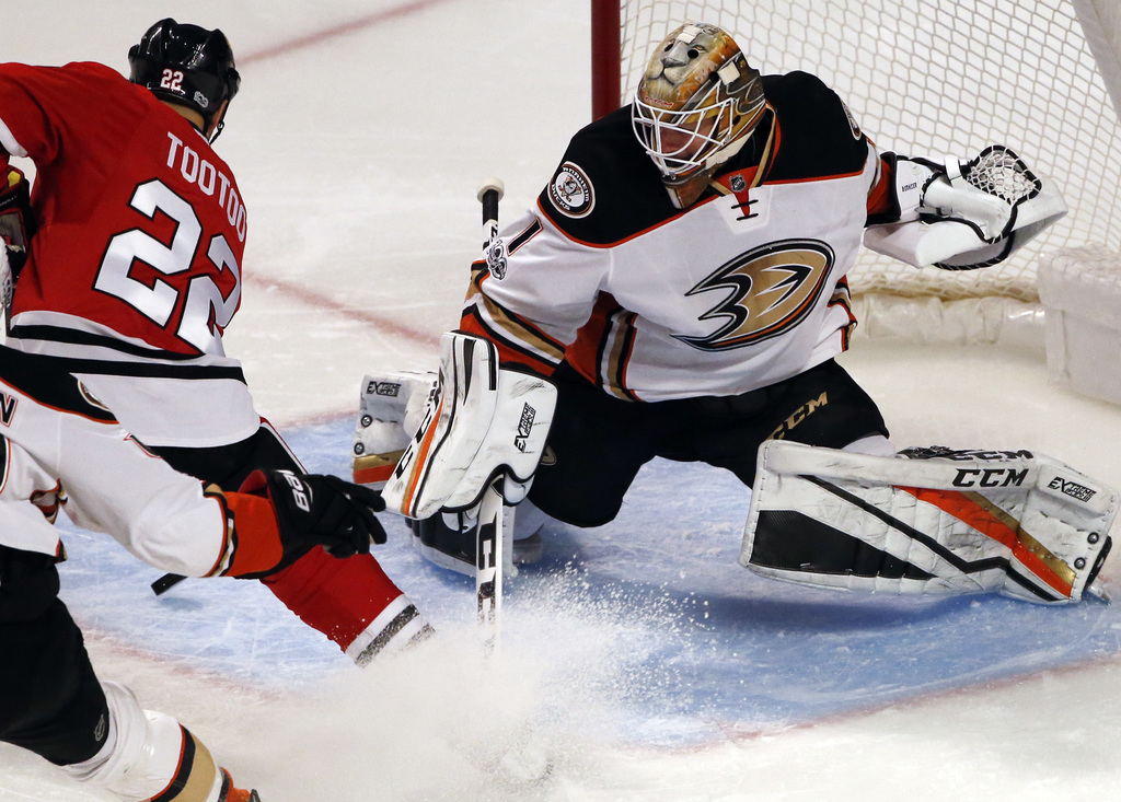 Anaheim Ducks goalie Jonathan Bernier, right, blocks a shot by Chicago Blackhawks right wing Jordin Tootoo during the second period of ...