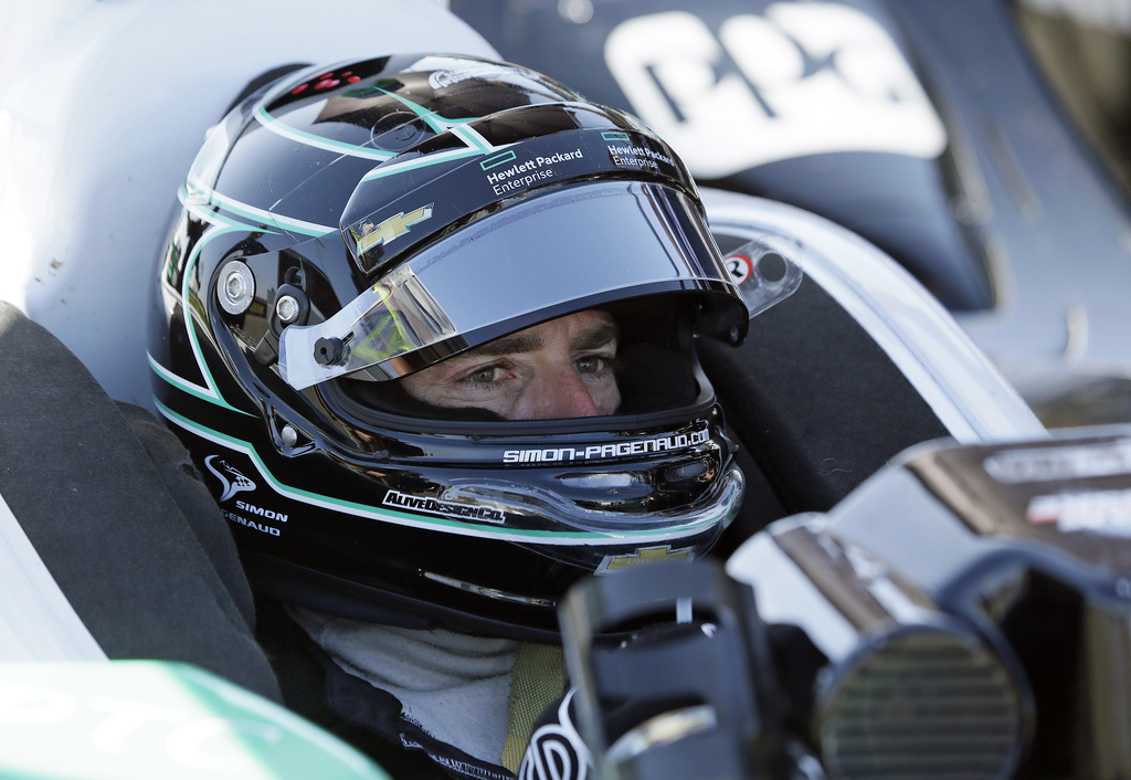 FILE - In this Sept. 17, 2016, file photo, Simon Pagenaud, of France, waits in his car for the start of practice at the IndyCar auto ra...