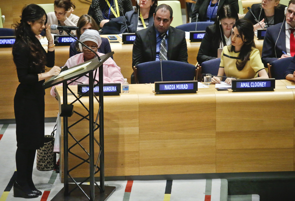 Human rights lawyer Amal Clooney, right, listens as her client Nadia Murad, left, a human rights activist and Yazidi genocide survivor,...