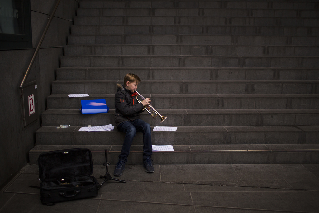 In this Friday, March 3, 2017 photo, Agne, 12, plays his trumpet as he practices in the centre of The Hague, The Netherlands. Of the Ne...