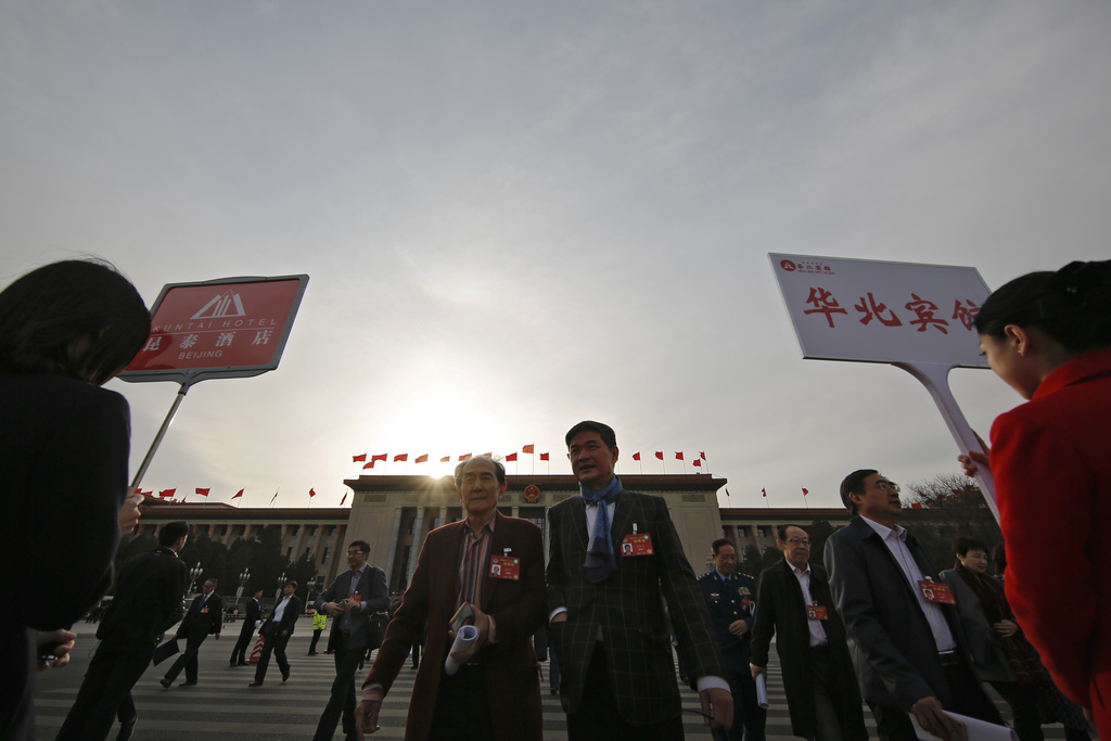 Delegates leave the Great Hall of the People after attending the Chinese People's Political Consultative Conference (CPPCC) in Beijing,...