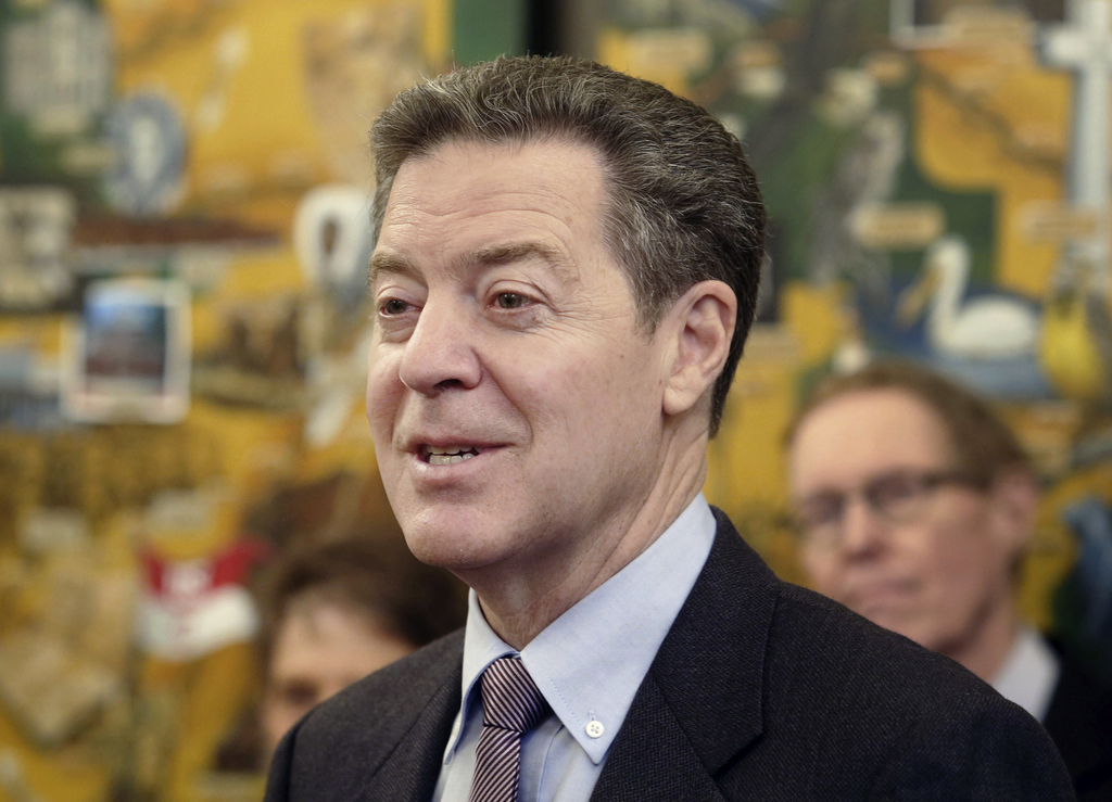 FILE - In this March 9, 2017 file photo, Kansas Gov. Sam Brownback speaks to media during a humanitarian award ceremony at the statehou...