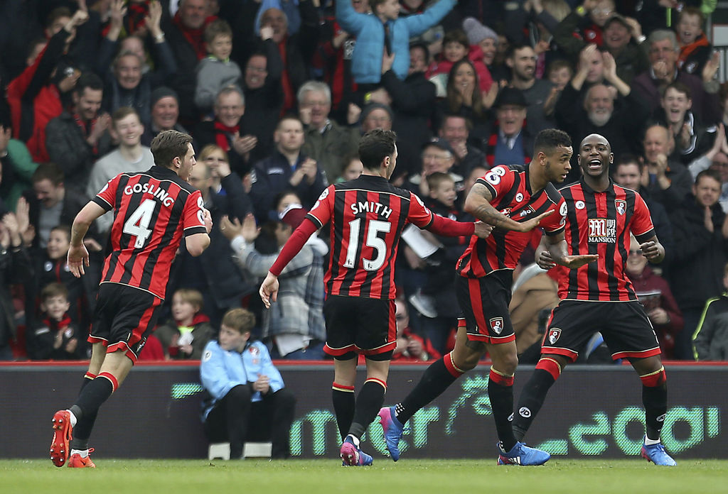 Bournemouth's Joshua King, centre right, celebrates scoring his side's first goal of the game with team mates during the English Premie...