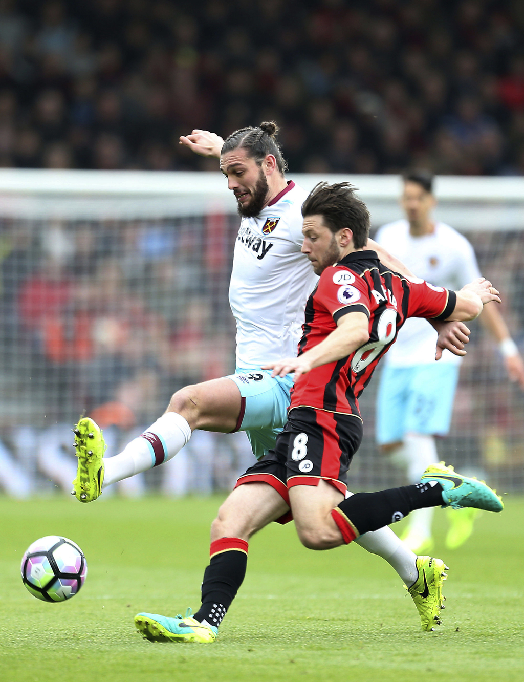 West Ham United's Andy Carroll, left, and Bournemouth's Harry Arter challenge for the ball during the English Premier League match West...