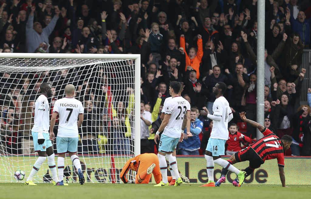 Bournemouth's Joshua King, right, scores his side's first goal of the game during the English Premier League match West Ham against Bou...