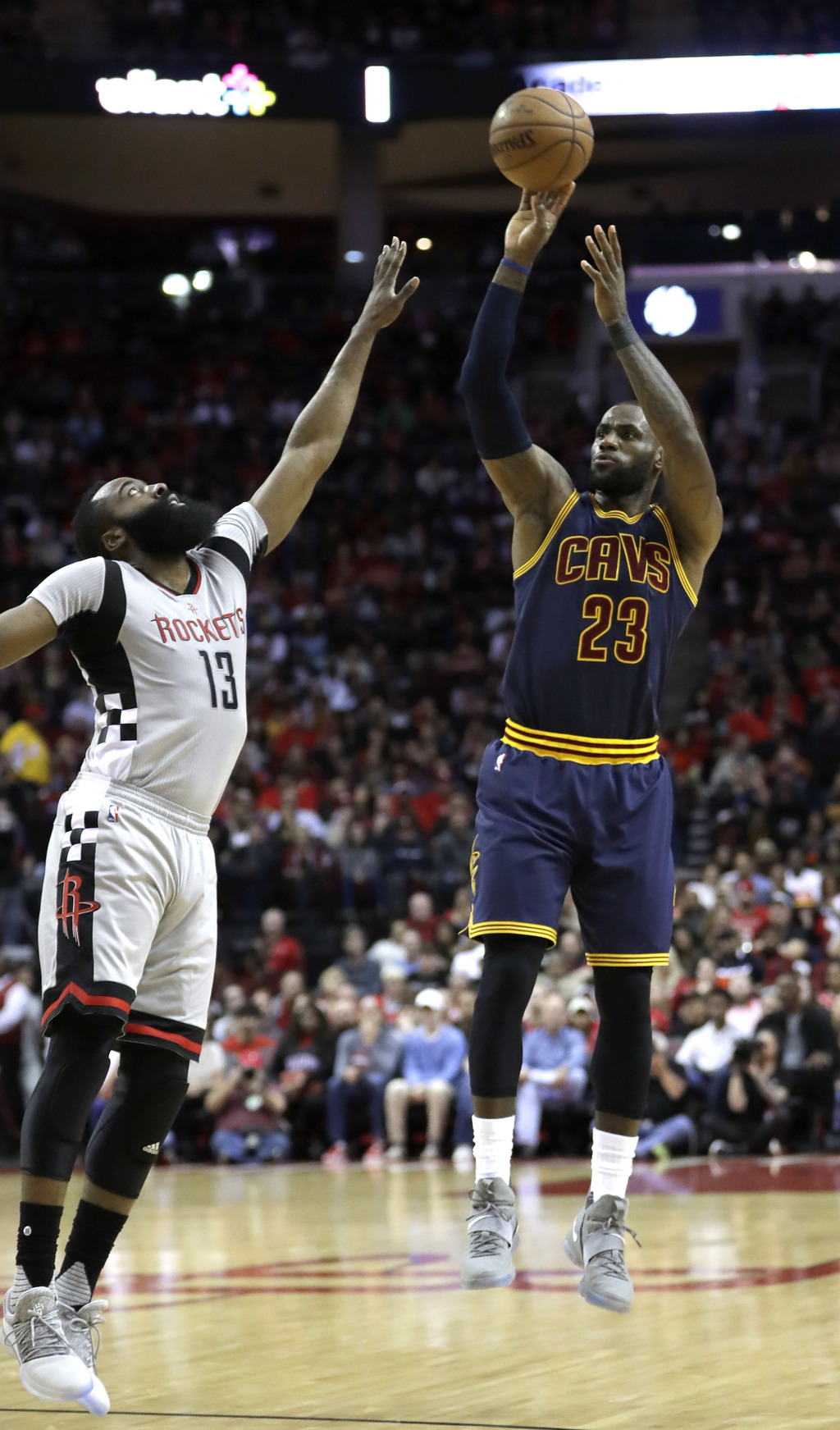 Cleveland Cavaliers' LeBron James (23) shoots as Houston Rockets' James Harden (13) defends during the first quarter of an NBA basketba...