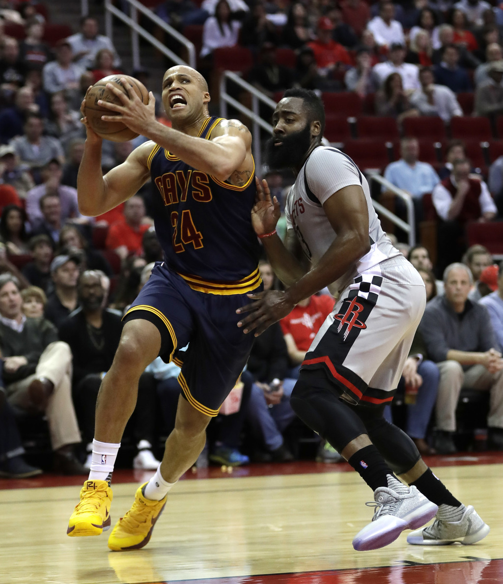 Cleveland Cavaliers' Richard Jefferson (24) drives toward the basket as Houston Rockets' James Harden (13) defends during the first qua...