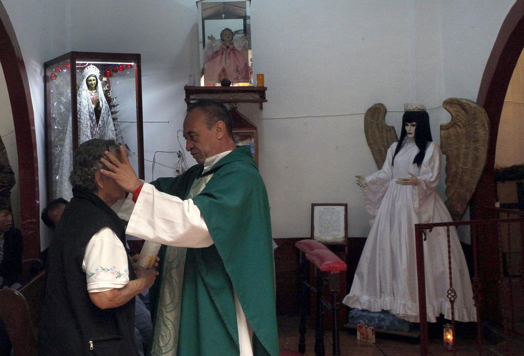 AP PHOTOS: Death Saint draws followers in Mex    | Taiwan News