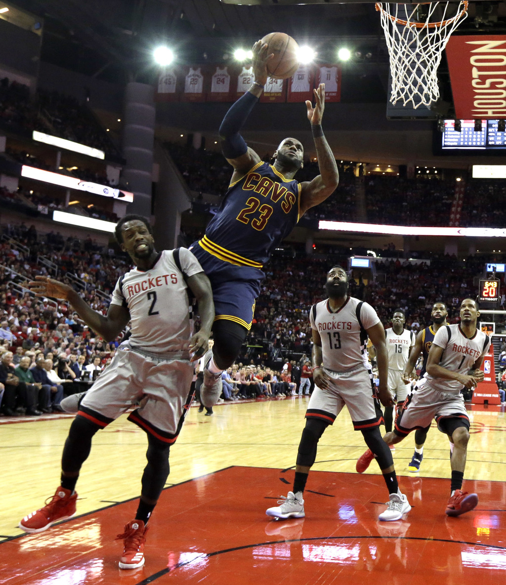 Cleveland Cavaliers' LeBron James (23) is fouled by Houston Rockets' Patrick Beverley (2) during the first quarter of an NBA basketball...