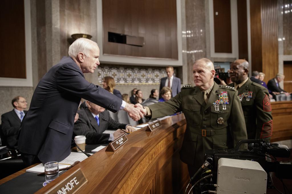 Senate Armed Services Committee Chairman Sen. John McCain, R-Ariz., left, welcomes Marine Corps Commandant Gen. Robert B. Neller, cente...
