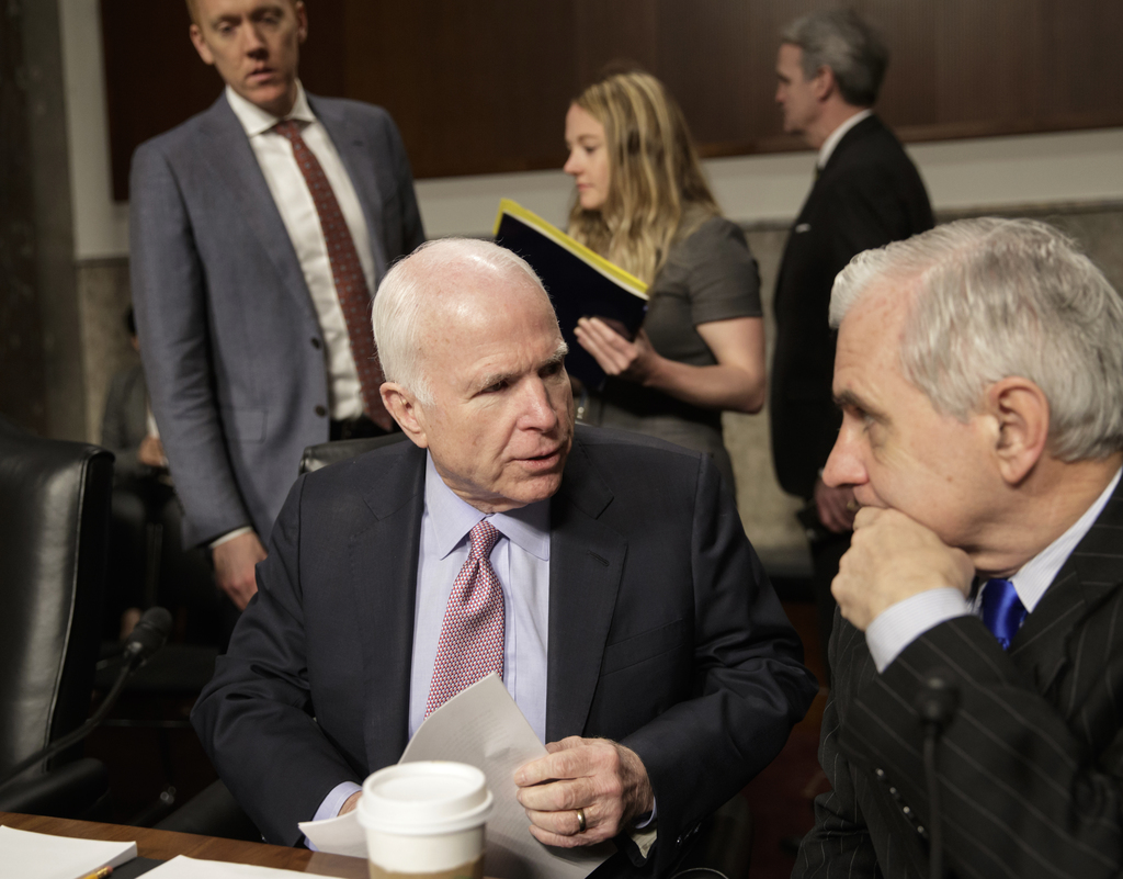 Senate Armed Services Committee Chairman Sen. John McCain, R-Ariz., left, confers with the committee's ranking member, Sen. Jack Reed, ...