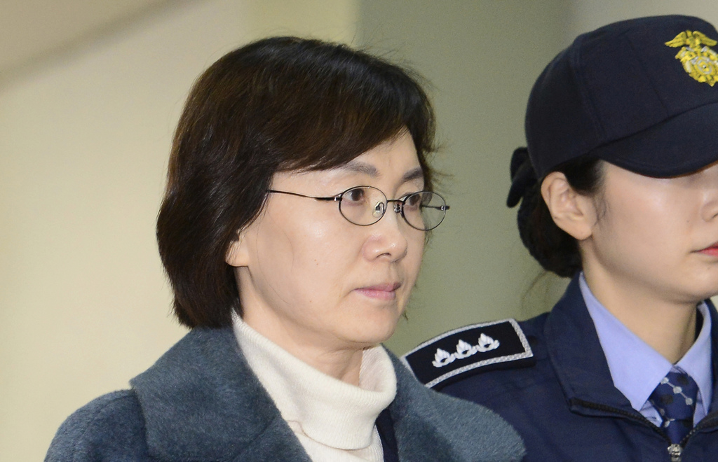 In this Feb. 26. 2017, photo, former Ewha Womans University President Choi Kyung-hee arrives at the office of the independent counsel i...