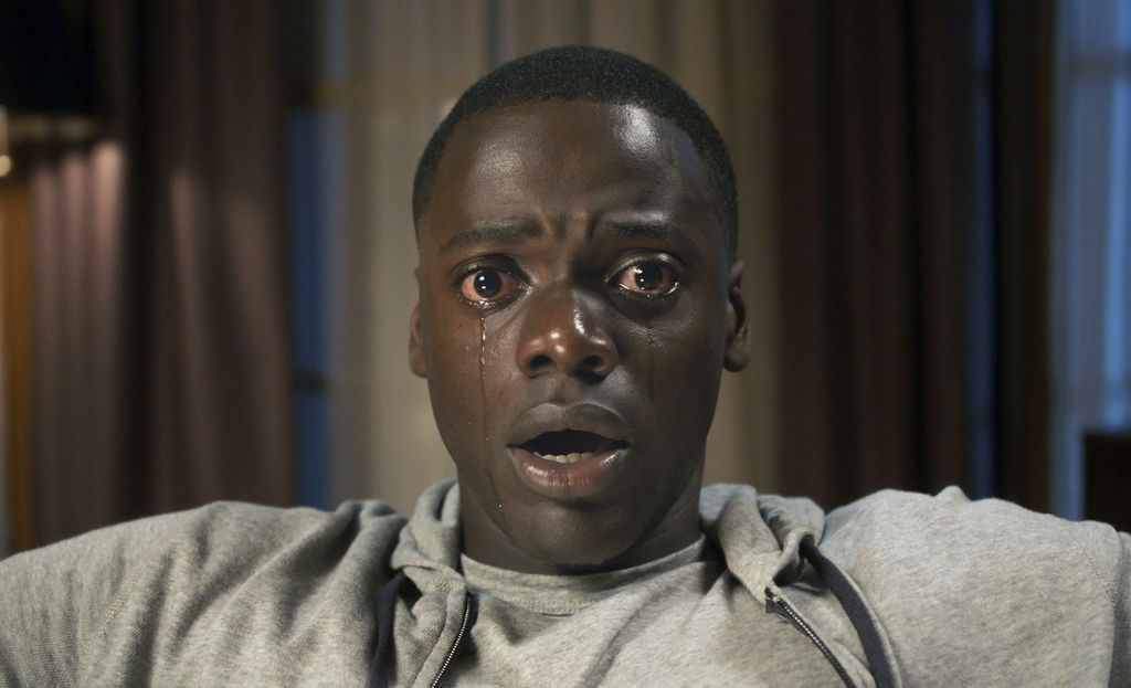 """This image released by Universal Pictures shows Daniel Kaluuya in a scene from, """"Get Out."""" Jordan Peele's thriller sensation """"Get Out"""" ..."""