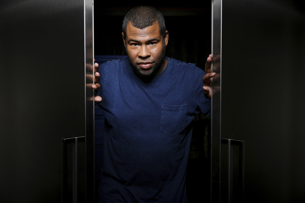 """In this Feb. 9, 2017 photo, Jordan Peele poses for a portrait at the SLS Hotel in Los Angeles to promote his film, """"Get Out."""" Peele's t..."""
