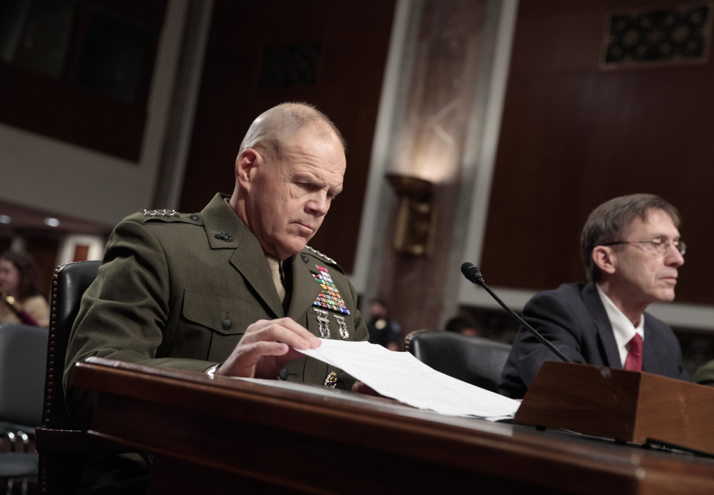 Marine Corps Commandant Gen. Robert B. Neller, left, and Acting Navy Secretary Sean J. Stackley, wait to testify on Capitol Hill in Was...