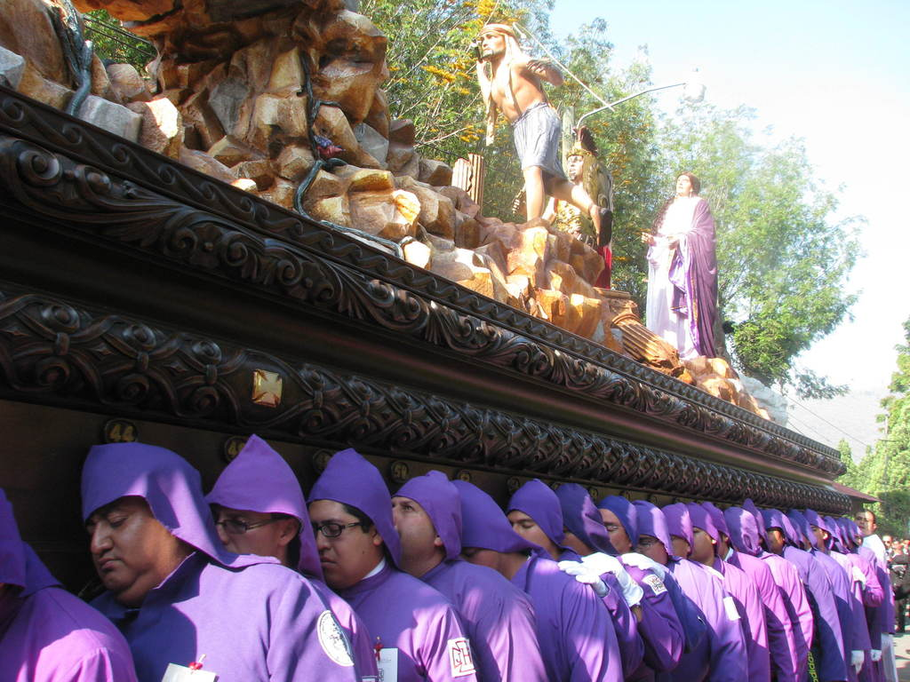 This March 22, 2015 photo shows the cucuruchos, volunteers who carry on their shoulders in procession a three-ton wooden float with rel...