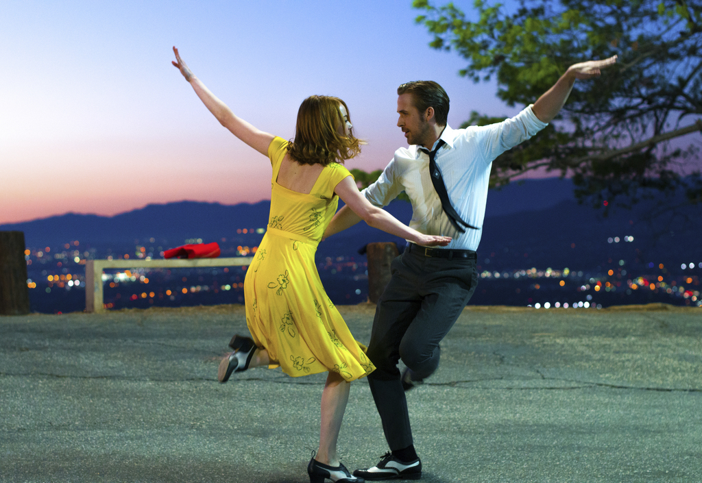 """FILE - This image released by Lionsgate shows Ryan Gosling, right, and Emma Stone in a scene from, """"La La Land."""" The film won many Osca..."""
