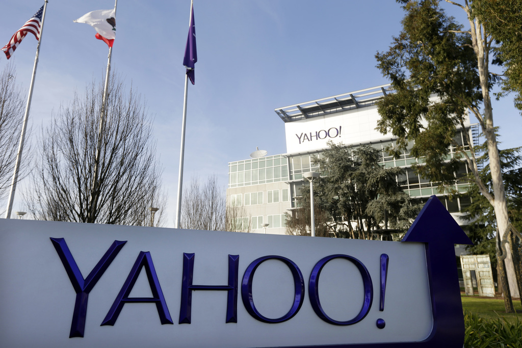 FILE - This Jan. 14, 2015, file photo shows a sign outside Yahoo's headquarters in Sunnyvale, Calif. In an indictment Wednesday, March ...