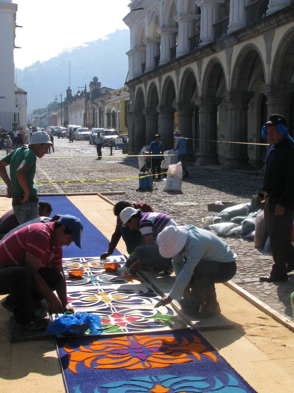 This March 22, 2015 photo shows people creating a colored sawdust carpet in the main square of Antigua, Guatemala on the morning of the...