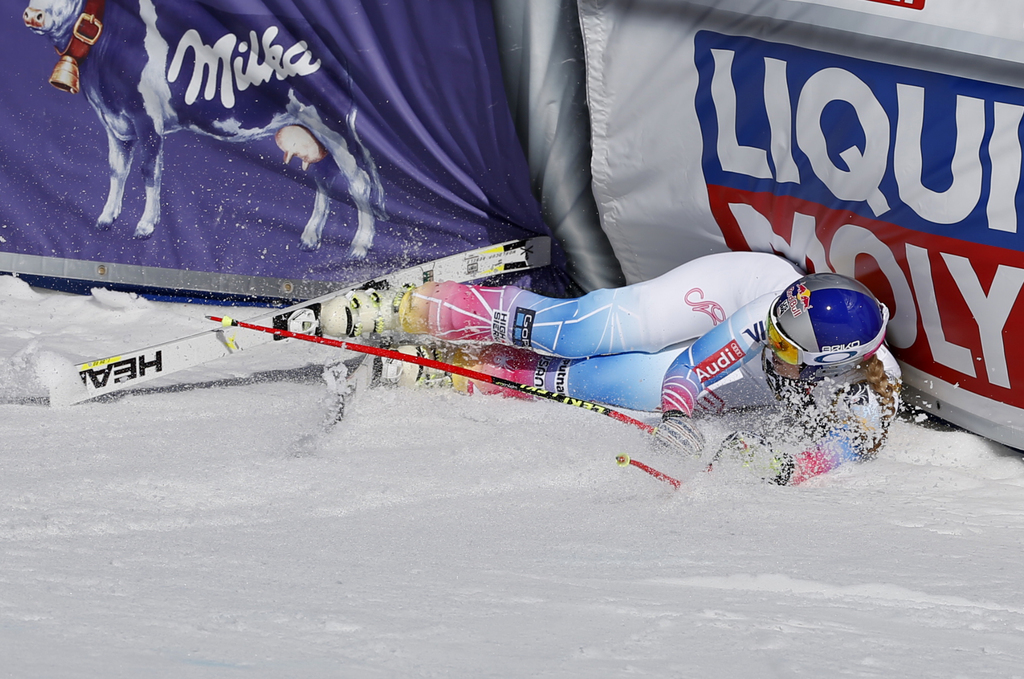 United States' Lindsey Vonn slides into a barrier after finishing a run at the women's World Cup downhill ski race Wednesday, March 15,...