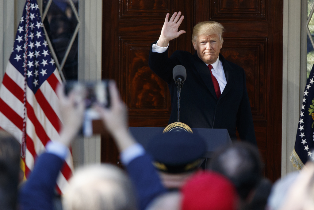 President Donald Trump waves after speaking at the Hermitage, the home of President Andrew Jackson, to commemorate Jackson's 250th birt...