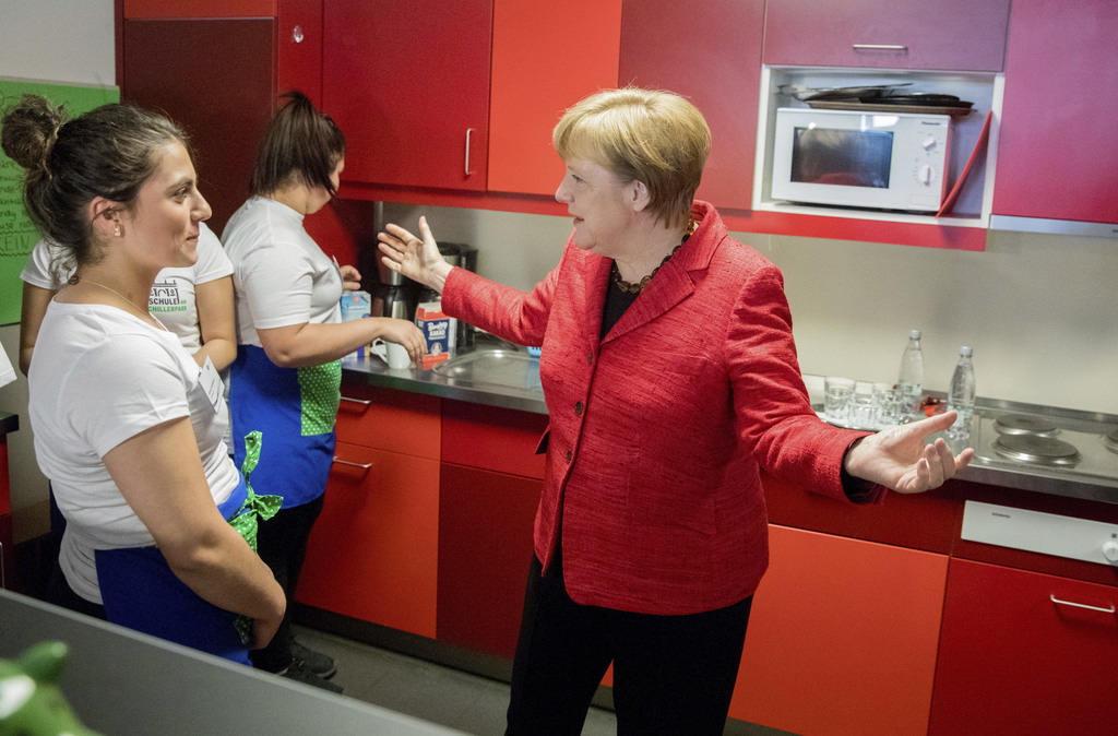 German Chancellor Angela Merkel talks to students at the student cafe at the 'Zukunftshaus' (lit. 'Future House') of the Paul Gerhard f...