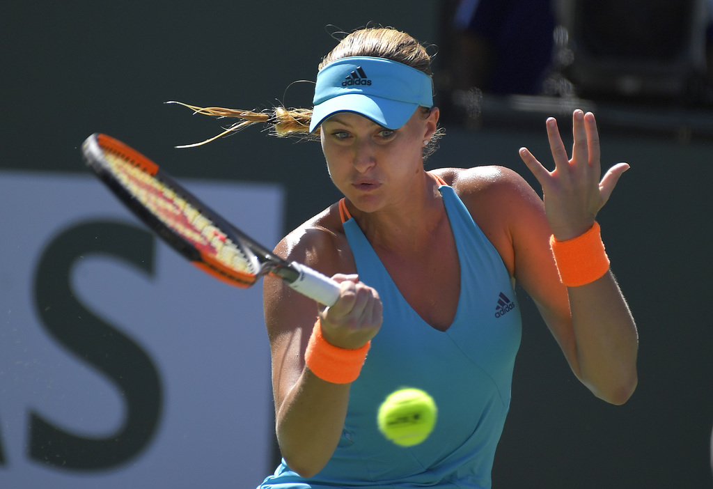 Kristina Mladenovic, of France, returns a shot to Caroline Wozniacki, of Denmark, at the BNP Paribas Open tennis tournament, Thursday, ...