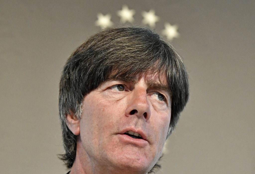 FILE - In this Aug. 29, 2016 file photo Germany's head coach Joachim Loew talks to the media under 4 stars at a press conference in Due...